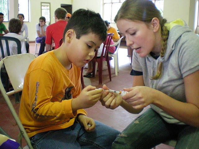 Merith help camper with insulin. Bolivia, 2008